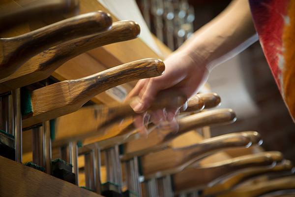 hands playing chimes